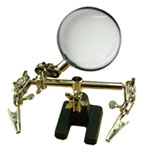 Helping hand with glass magnifier